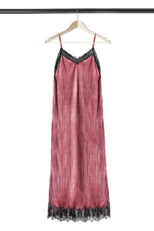 Pink nightgown hanging on wooden clothes rack isolated over white