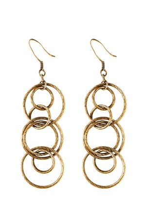 Pair of gold earrings rings on white background