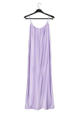 Long elegant violet dress on black clothes rack isolated over white Stockfoto