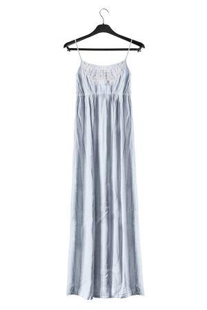 Light blue long sundress on black clothes rack isolated over white Stockfoto