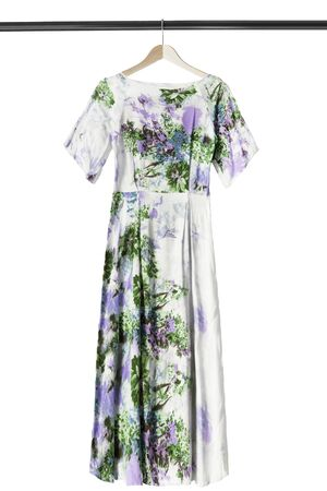 Elegant silk long dress on wooden clothes rack isolated over white