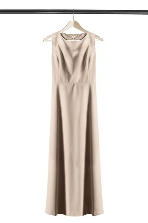 Elegant long beige dress on wooden clothes rack isolated over white