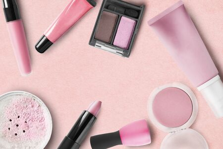Cosmetic collection in shades of pink on rose background