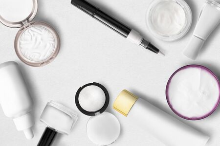 Group of white cosmetic objects on white paper background