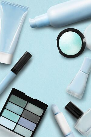 Cosmetic collection in shades of blue and cyan on paper background