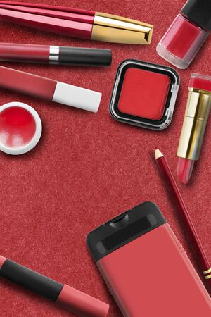 Red colored cosmetic objects collection on red paper background