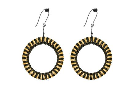 Ethnic textile black and yellow hoop earrings on white background