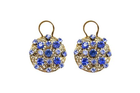 Vintage gold earrings with blue crystals isolated over white