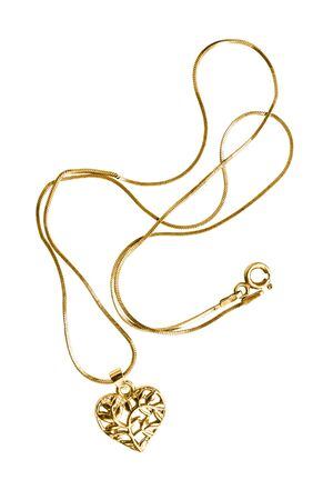 Gold necklace with heart shaped pendant on white background 免版税图像