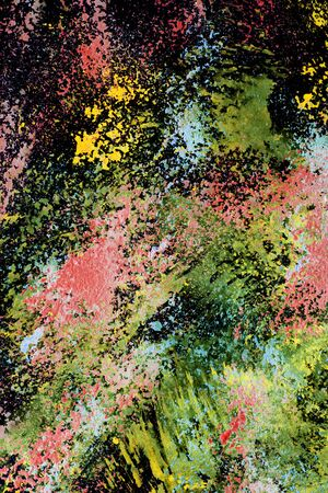 Abstract splashes of neon colorful paint on black as a background