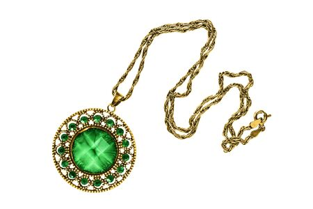 Gold necklace with large malachite pendant and green emeralds isolated over white