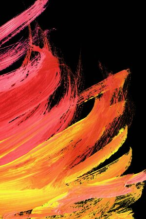 Yellow and pink paint brush strokes on black as a background