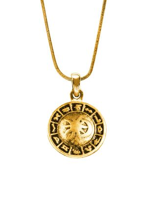 Vintage gold zodiac pendant hanging on a chain on white background