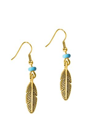 Gold elegant earrings in the shape of a plume isolated over white