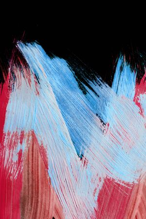 Abstract blue and red paint brush strokes on black background