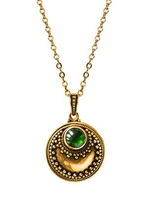 Vintage gold emerald pendant hanging on a chain on white background