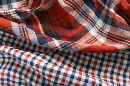 Red and blue draped plaid cotton as a background