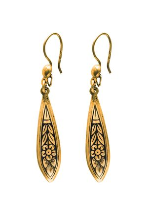 Pair of vintage gold earrings on white background