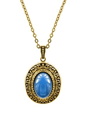 Vintage gold pendant with blue mineral hanging on a chain on white background