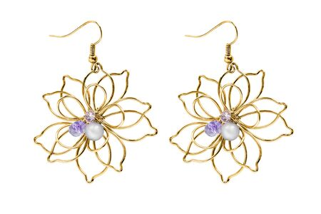 Elegant gold floral earrings with purple crystals and pearl on white background
