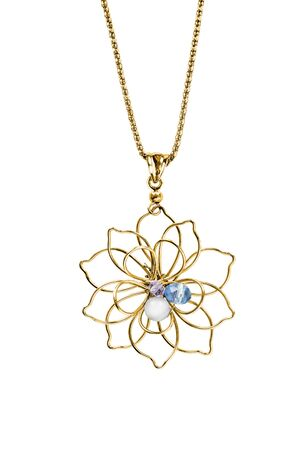 Gold flower pendant with crystals and pearl hanging on a chain on white background 写真素材