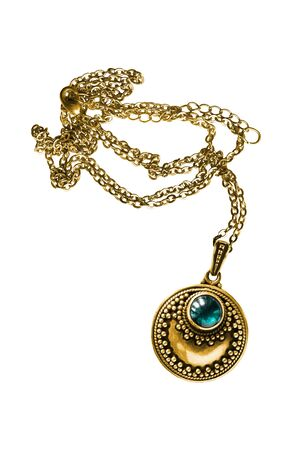 Vintage gold necklace with blue topaz crystal isolated over white
