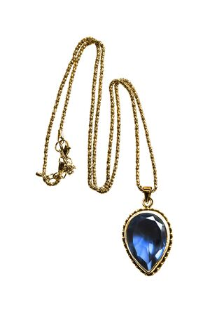 Gold necklace with large blue sapphire isolated over white