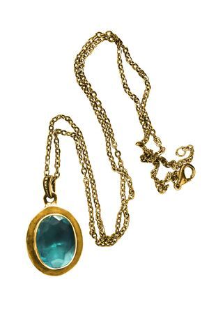 Vintage gold necklace with large aquamarine pendant on white background