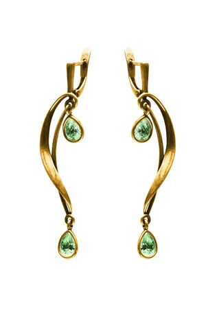 Pair of elegant emerald drop gold earrings on white background 写真素材