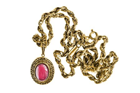 Vintage gold necklace with pink mineral pendant isolated over white 写真素材