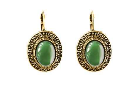 Vintage gold earrings with large emeralds isolated over white