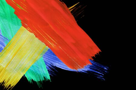 Colorful gouache paint abstract strokes on black background