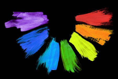 Rainbow colored neon paint strokes on black background