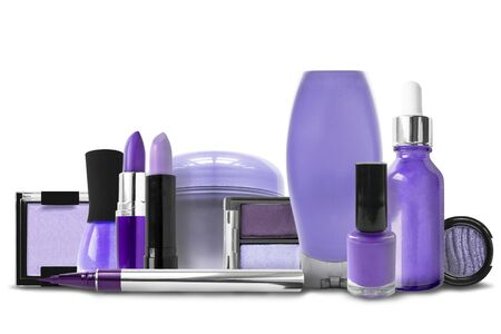 Cosmetics and makerup jars in shades of purple isolated over white 写真素材