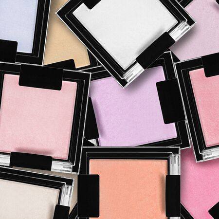 Collection of colorful blush and highlighter boxes closeup