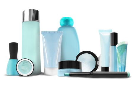 Collection of cyan colored cosmetic jars on white background