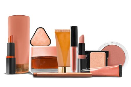 Orange colored cosmetic and makeup collection on white background