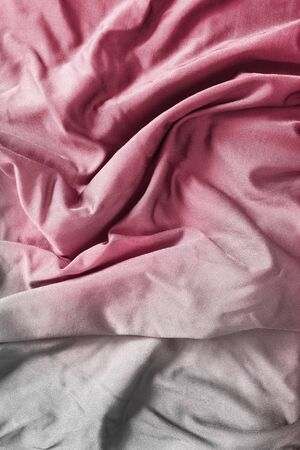 White and pink draped fabrics closeup as a background