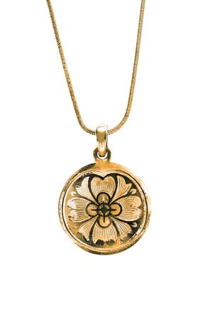 Vintage gold pendant hanging on a chain on white background