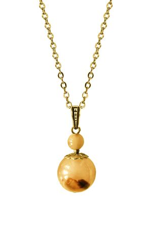 Amber pendant hanging on gold chain on white background