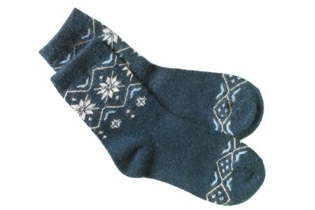 Pair of blue wool knitted socks on white background