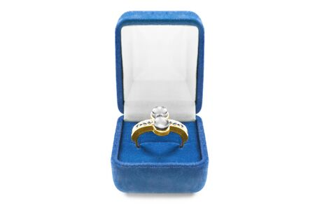 Blue jewel box with a gold pearl ring on white background