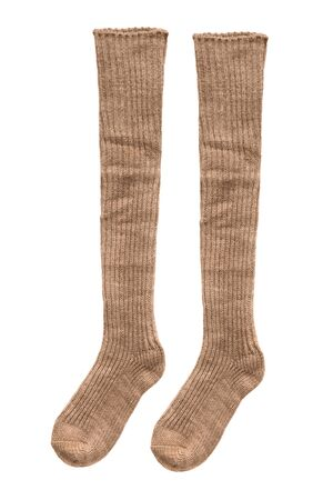 Pair of brown knitted stockings on white background Banco de Imagens