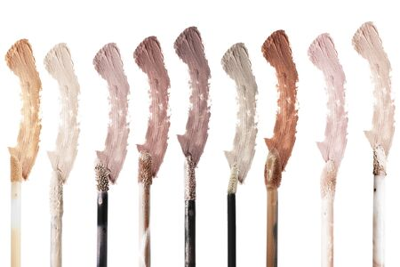 Palette of liquid mat concealer brushes and color swatches on white background Reklamní fotografie