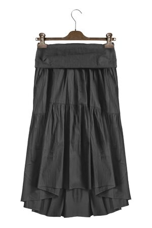 Black cotton skirt hanging on clothes rack isolated over white Zdjęcie Seryjne