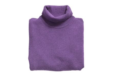 Folded purple wool basic sweater isolated over white