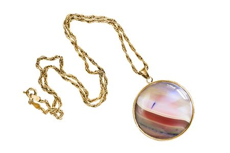 Elegant large pink mineral pendant on gold chain isolated over white