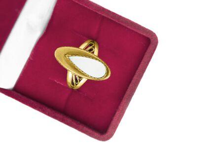 Vintage elegant gold ring in red jewel box on white background Imagens