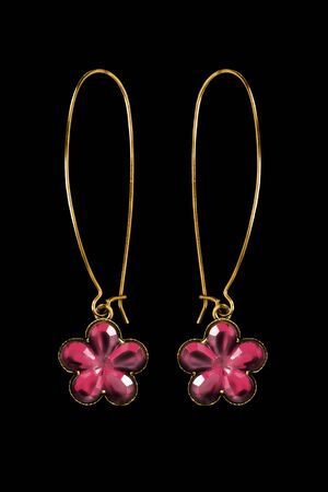 Pair of elegant gold pink crystals floral earrings on black background
