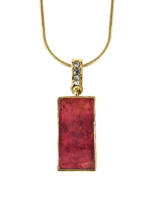 Vintage red mineral pendant hanging on gold chain on white background